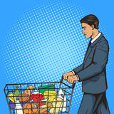 Businessman with shopping cart pop art vector royalty free illustration