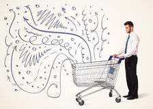 Businessman with shopping cart. Businessman pushing a shopping cart curly lines, arrows coming out of it Royalty Free Stock Images