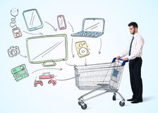 Businessman with shopping cart Stock Image