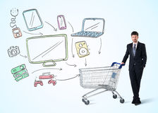 Businessman with shopping cart Royalty Free Stock Images