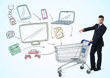 Businessman with shopping cart Stock Images