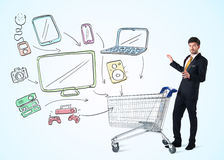 Businessman with shopping cart Royalty Free Stock Photo