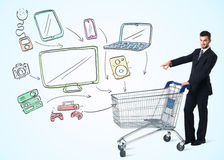 Businessman with shopping cart Stock Photo