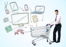 Businessman with shopping cart Royalty Free Stock Image