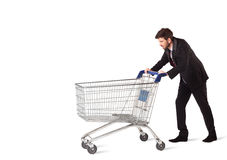 Businessman with shopping cart Royalty Free Stock Photos