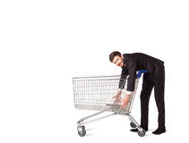 Businessman with shopping cart. Businessman pushing a shopping cart on isolated background Stock Photography