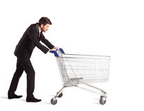 Businessman with shopping cart Stock Photography