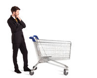 Businessman with shopping cart Stock Photos