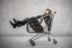 Businessman into a shopping cart Stock Image