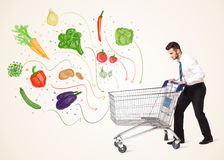 Businessman with shopping cart with vegetables Stock Photography