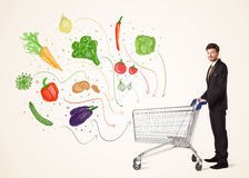 Businessman with shopping cart with vegetables. Businessman pushing a shopping cart and healthy vegetables coming out of it Stock Images