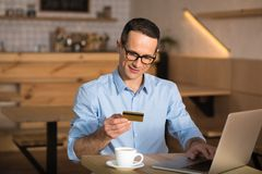 Businessman shopping online with credit card royalty free stock images