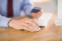 Businessman shopping online at desk Royalty Free Stock Photo