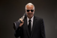 Businessman with shotgun. Businessman in suit with shotgun stock images