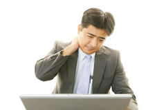 Businessman with shoulder pain. Stock Photos