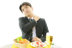 Businessman with shoulder pain. Royalty Free Stock Images