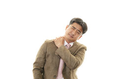 Businessman with shoulder pain. Royalty Free Stock Image