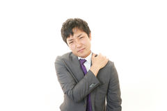 Businessman with shoulder pain. Stock Photography