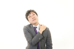 Businessman with shoulder pain. stock image