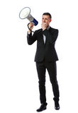 Businessman shout through megaphon. Full length portrait of businessman shout through megaphone isolated on white background Stock Photo