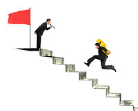 Businessman shouting another carrying USD on money stairs with f Stock Images
