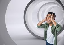 Businessman shouting anxiously in tunnel. Digital composite of Businessman shouting anxiously in tunnel Stock Photo
