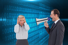 Businessman shouting at colleague with his bullhorn Royalty Free Stock Image