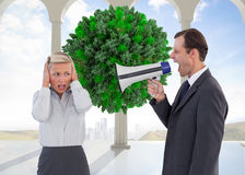 Businessman shouting at colleague with his bullhorn. Composite image of businessman shouting at colleague with his bullhorn Royalty Free Stock Images
