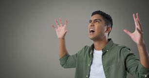 Businessman shouting desperately with brown background Stock Photography