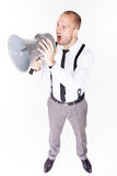 Businessman shouting on his megaphone Royalty Free Stock Photos