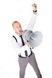 Businessman shouting on his megaphone Stock Image