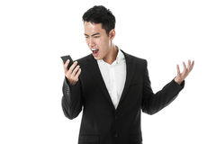 Businessman shouting at his phone Royalty Free Stock Image