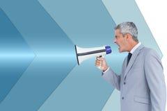Businessman shouting in loudspeaker Royalty Free Stock Photo
