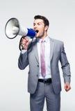 Businessman shouting in loudspeaker Stock Image