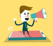 Businessman shouting with loudspeaker from smart p Stock Photography