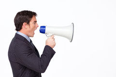 Businessman shouting through a megaphon royalty free stock image