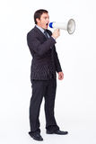 Businessman shouting through a megaphone. Standing businessman shouting through a megaphone agaisnt white Stock Images