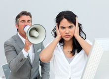 Businessman shouting through a megaphone Stock Photography