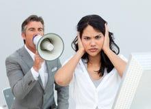 Businessman shouting through a megaphone Stock Photography