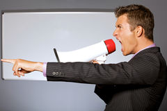 Businessman shouting through megaphone Royalty Free Stock Photography