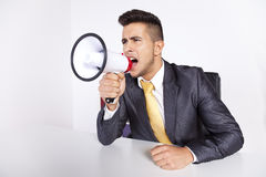Businessman shouting with a megaphone Royalty Free Stock Photo