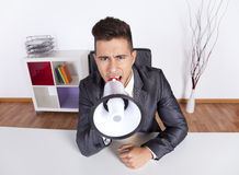 Businessman shouting with a megaphone Royalty Free Stock Photography