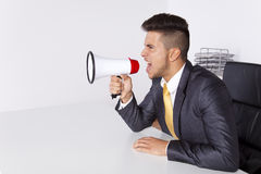 Businessman shouting with a megaphone Stock Photo