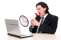 Businessman shouting through megaphone Royalty Free Stock Photos