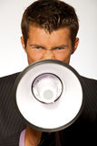 Businessman shouting through megaphone Stock Photo