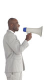Businessman shouting in a Megaphone Royalty Free Stock Image