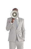 Businessman shouting in a Megaphone Stock Image