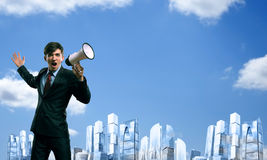 Businessman shouting into a megaphone Stock Photos
