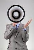 Businessman shouting through a megaphone royalty free stock photos