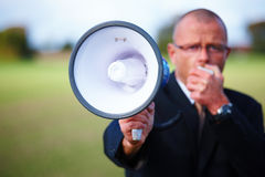Businessman shouting in megaphone about copyspace Royalty Free Stock Image